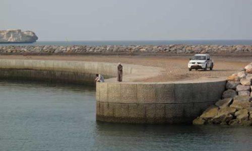 A concrete-reinforced shoreline, Yiti, Oman