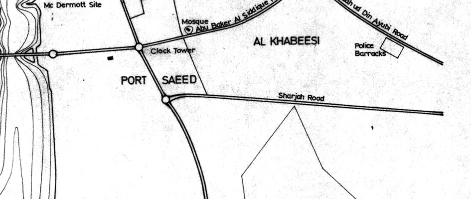 """Photo at the top is from 1968; above is from the mid-1970s. Both images capture the Dubai–Sharjah road (left to right), a vital commercial artery and one of the first hardened roads in the region. Somewhere along its stretches was a """"permanent Palestine exhibition."""" Courtesy of John R. Harris Library."""
